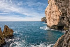 The rocky peninsula of Capo Caccia. With high cliffs, is located near Alghero; in this area there are the famous Neptune`s Caves Royalty Free Stock Photo