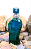 Rocky perfume bottle Royalty Free Stock Images