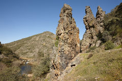 Rocky pinnacles and stream in Boqueron route. Cabaneros, Spain. Horizontal Royalty Free Stock Image
