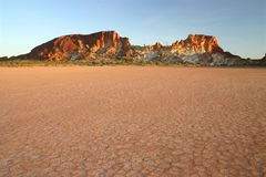 Rocky range against parched grounds. Parched grounds with famous rocky range. Rainbow valley, Southern Northern Territory, Australia Stock Photos