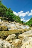 Rocky Ravine. A ravine with rocks and cascade in the tropical forest of Java Stock Image