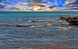 A Rocky Reef In The Sea With A Dramatic Sky Royalty Free Stock Photo