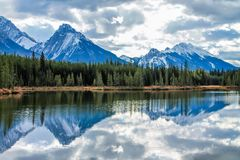 Rocky reflection Spray Lake, Peter Lougheed Provincial Park. Showing the Rocky Mountain Royalty Free Stock Image