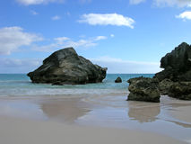 Rocky Reflections. Rocks on the beach at Horseshoe Bay, Bermuda royalty free stock photos