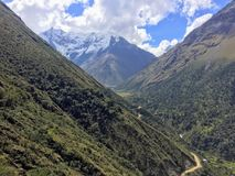 The rocky, remote and majestic terrain of the Salkantay Trek, high in the Andes mountains, on the way to Machu Picchu Stock Image