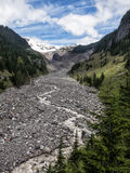 Rocky river bed through mountain valley in drought year Royalty Free Stock Images