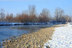 Rocky river covered by snow Royalty Free Stock Image