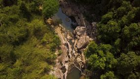 Rocky river landscape in mountain aerial view. Aerial shooting from flying drone over mountain river with big stones and. Green forest stock footage