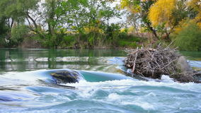 Rocky river near waterfall. Manavgat waterfall in Turkey during summer day stock video footage