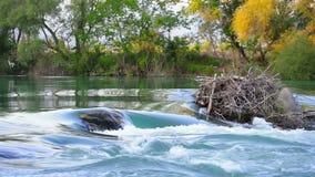 Rocky river near waterfall. stock video footage
