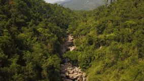 Rocky river in tropical forest and mountain landscape aerial view. Drone shot mountain river with big stones in. Rocky river in tropical forest and mountain stock video