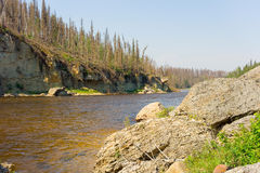 A rocky riverbank in the northwest territories Stock Photography