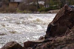 Rocky riverbank and splashing river Royalty Free Stock Photo