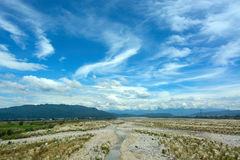 Rocky riverbed and blue summer sky in Yunlin County, Taiwan Royalty Free Stock Photography