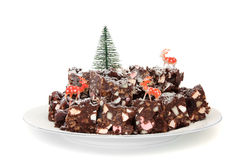 Rocky Road. Plate of Rocky Road confectionery with christmas decorations isolated on white background Stock Photography