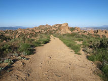 Rocky Road. A simple dirt road on a rocky mountain ridge in Southern California Royalty Free Stock Images