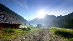 Rocky road between cottages in the valley Chocholowska at sunrise, Tatra Mountains, Poland. Rocky road between cottages in the valley Chocholowska at sunrise stock video footage