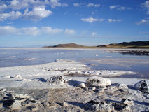 Rocky salty shore and water of the great Salt Lake with mountain Royalty Free Stock Photo