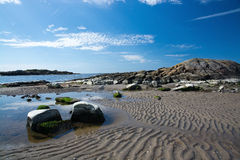 Rocky sandy beach landscape. And blue sky in Falkenberg, Sweden Royalty Free Stock Photos