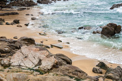 Rocky Sandy Beach. Seascape of rocky and sandy beach at low tide stock photos
