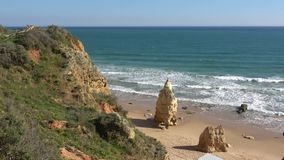 Picturesque ocean cliff and beach in Portugal stock video footage