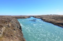 Rocky scienic landscape in Iceland with a river. Flowing through stock photo