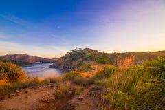 Rocky sea beach sunrise blue sky with grass. Phuket Thailand Stock Photo