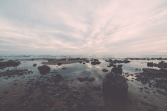 Rocky sea beach with wide angle perspective Stock Photos