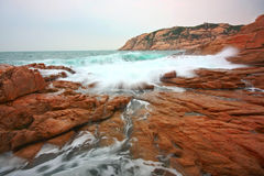 Rocky sea coast and blurred water in shek o Royalty Free Stock Photos