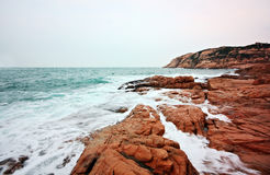 Rocky sea coast and blurred water in shek o Royalty Free Stock Image