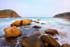 Rocky sea coast and blurred water in shek o Stock Image