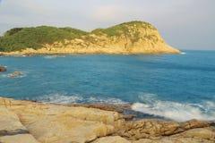 Rocky sea coast and blurred water in shek o,hong kong Royalty Free Stock Photos