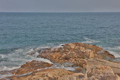 Rocky sea coast and blurred water in shek o,hong kong Stock Images