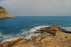Rocky sea coast and blurred water in shek o,hong kong Stock Photography