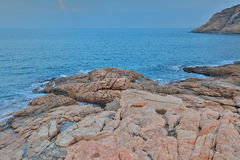 Rocky sea coast and blurred water in shek o Stock Photography