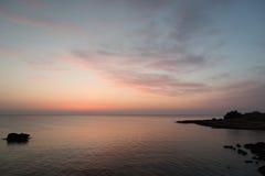 Rocky sea coast. Right before sunrise Stock Image