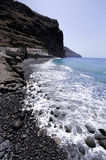 The rocky sea coastline in the destroyed village La Dama stock image