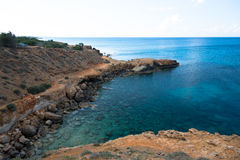 Rocky sea cost. And crystal clear waters of Cyprus Royalty Free Stock Photos