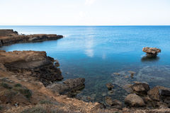 Rocky sea cost. And crystal clear waters of Cyprus Stock Photography