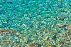 Rocky sea floor and crystal clear turqoise water Stock Photo