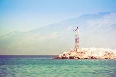 Rocky sea shore with beacon. Horizontal orientation photo Royalty Free Stock Photo