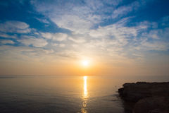 Rocky sea shore. On the beautiful sunrise Stock Image