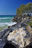 Rocky sea Shore and clear sky Royalty Free Stock Photo