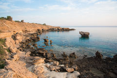 Rocky sea shore. And crystal clear sea water Stock Photography