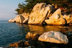 Rocky sea shore. At dawn Stock Photography