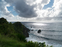 Rocky sea shore  dramatic sky in Maui Hawaii Royalty Free Stock Photography