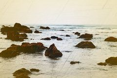 Rocky Sea Shore. This is an image created by processing a photograph of rocky sea shore at Ware Beach near Ganpatipule, India Stock Photos