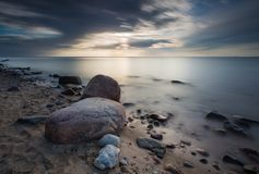 Rocky sea shore, long exposure photo Royalty Free Stock Image