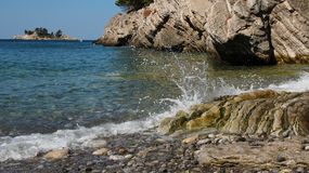 Waves Smashing Against Rocks. Rocky sea shore in the summer time Stock Photo