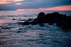 Rocky Sea Shore during Sun Set Royalty Free Stock Photography